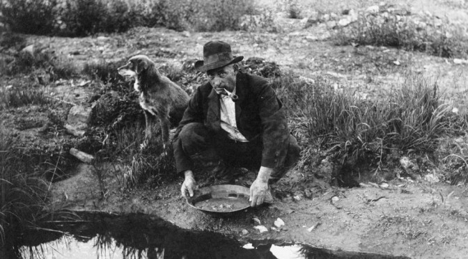 man panning for gold, metaphor for sifting through blogging ideas